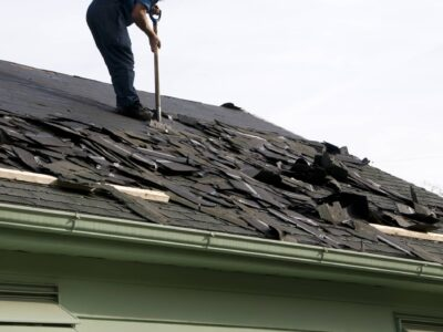 This is an image of a contractor preparing to replace a damaged roof.