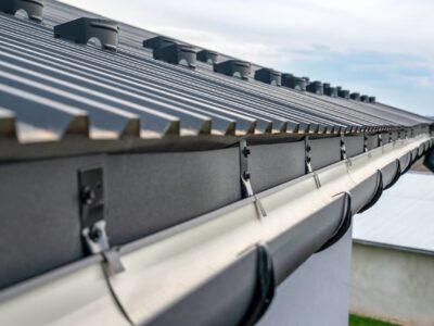This is an image of a newly installed rain gutter on a residential property.